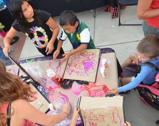 Children decorate reusable shopping bags at the 2012 Hyattsville Arts Festival. Photo courtesy of Michael Theis.