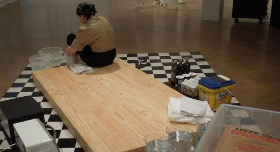 Annie Rose Hanson preparing for her performance, Proofing Ambivalence at Room Temperature, at the Corcoran Gallery in Spring 2013, photograph courtesy of the artist