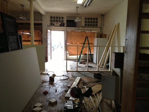 Renovations are underway.  Note the construction of the halfwall that will divide gallery from studio.  Photo courtesy of Ani Kasten.