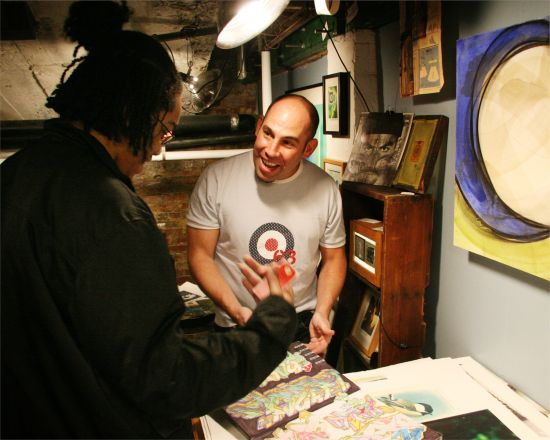 Brian Petro greets a visitor during the MCA Open Studios. Photo credit: Luis Gomez.