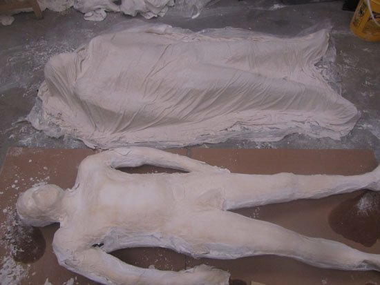 """Levester Williams, Work-In Progress of Packaged, 'Cast' prison bed sheet of black male body, 10"""" x 72"""" x 35"""". Photo courtesy of the artist."""