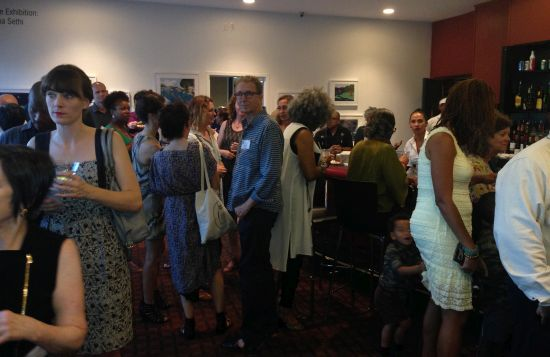 Reception Attendees and Artists mingle after keynote remarks.  Photo by Eric Hope for East City Art.