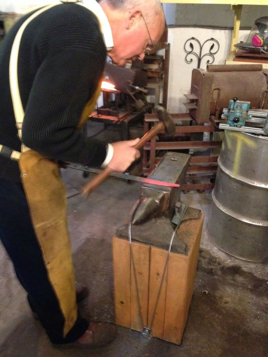 "Fontana Forge Proprietor John Dittmeier shaping steel over ""Mister Stout"". Photo by Eric Hope for East City Art."