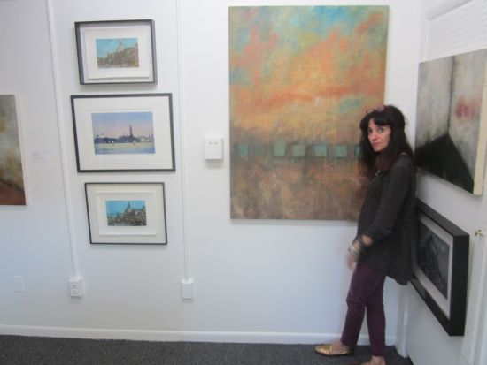 Adah Rose Bitterbaum with works in her gallery.  Photo courtesy of Adah Rose Bitterbaum.