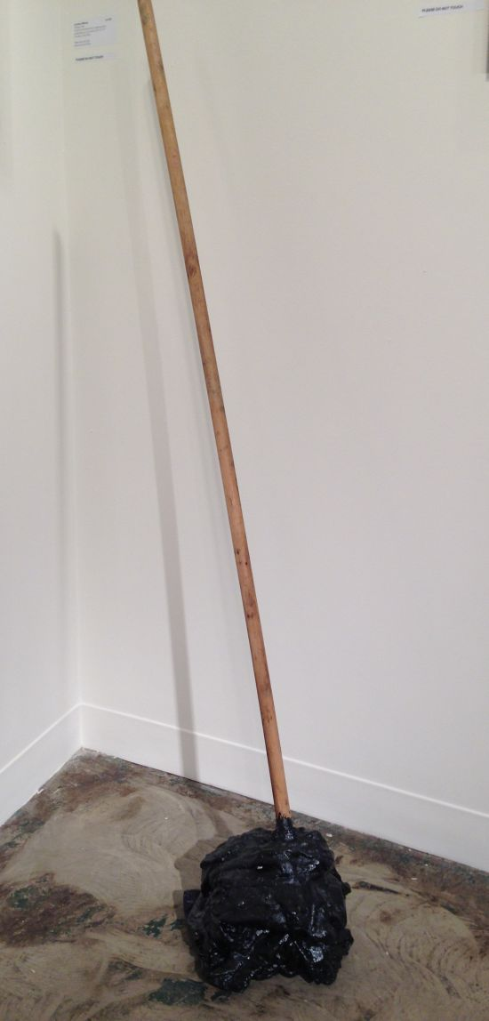 "Levester Williams Sulking, 2014 Unclean bed sheet from a Virginia adult penitentiary, tar and wood, 59"" x 11"" x 11"" Courtesy of the Artist Photo by Eric Hope for East City Art."