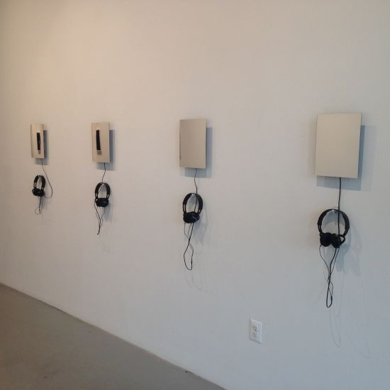 The making of an identity series: (from right to left)  Black American; Hispanic/Latino; Haitian; West Indian, 2015 9 x 12 inches plexiglass, mp3 player with 2:30 audio loop, headphones Photo for East City Art by Eric Hope