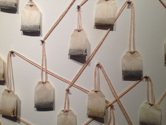 "Compassion, 2016 (detail) Nicole Salimbene 30"" x 40"" Tea bags, thread, ribbon, metal pins, acrylic paint on canvas. Photo for East City Art by Eric Hope."