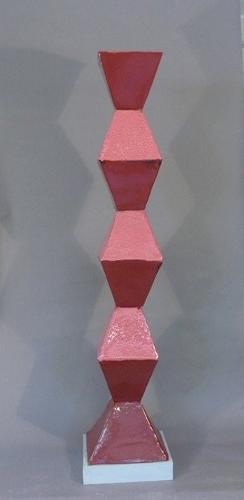 Jan Acton, Red Tower, high fired ceramic with oil spot glaze, 71x15x15 inches, 2015. Courtesy of Claudia Rousseau.
