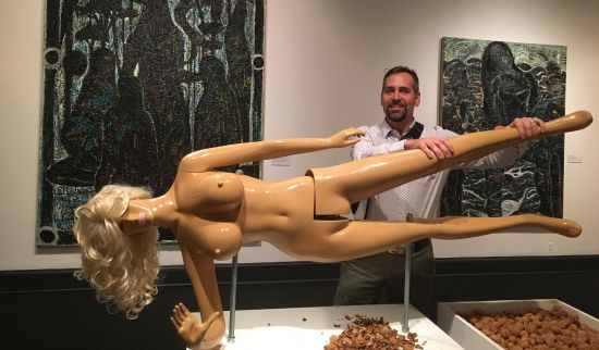 The author prepares to manipulate Jennifer Rubell's Lysa III. Fiberglass, resin, and steel, 72 x 62 x 24 in. Photo courtesy of Jan Aucker for East City Art.