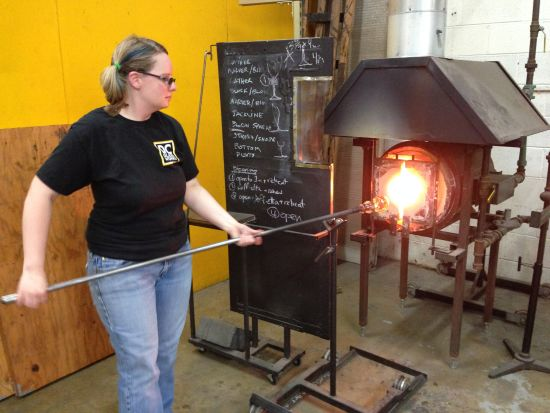 DC Glassworks artist Beth Hess prepares hot glass for shaping.  Photo by Eric Hope for East City Art.