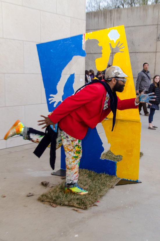 """BK ADAMS.I AM ART performing signature pose, the """"artist bow."""" Photo courtesy of the artist."""