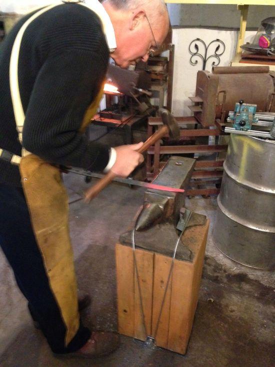 "Fontana Forge Proprietor John Dittmeier shaping steel over ""Mister Stout"". Photo by Eric Hope for East City Art."