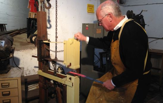 Dittmeier demonstrates the use of his foot-powered treadle hammer. Photo by Eric Hope for East City Art.
