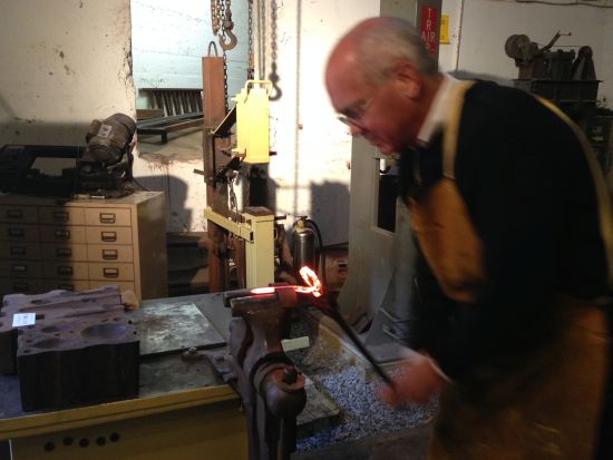 Bending a hot timber spike. Photo by Eric Hope for East City Art.