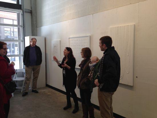 Lisa K Rosenstein presenting an informal artist's talk.  Photo for East City Art by Eric Hope.