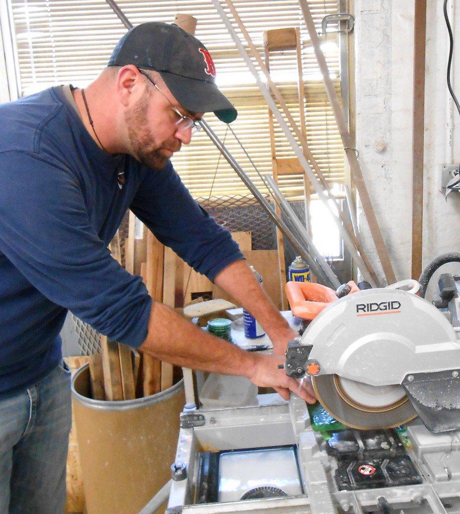 Derek Hambly working in the Washington Glass School cold shop in Mount Rainier, MD.