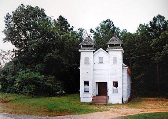 "William Christenberry, Church, Sprott, Alabama, 1981, Ed. 9, Printed 2015, archival pigment print, 44"" x 54"" Courtesy of HEMPHILL."