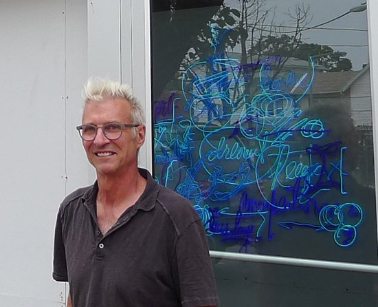 Craig Kraft in front of his new studio on Good Hope Road SE.  Image by Phil Hutinet for East City Art.