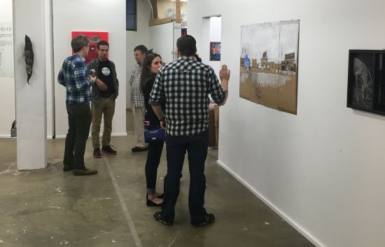 Visitors take in the art at opening night of The Critiqued. Photo for East City Art by Eric Hope.