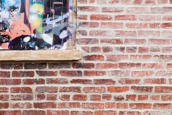 Art! America: Graffiti covered window and brick wall by 52 O Street. Photographer Jonathan Ellis.