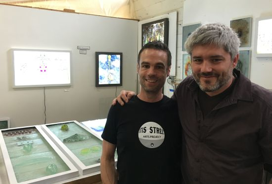 Otis Street Art Project co-founders David Mordini and Shawn Hennessey in Hennessey's workspace.