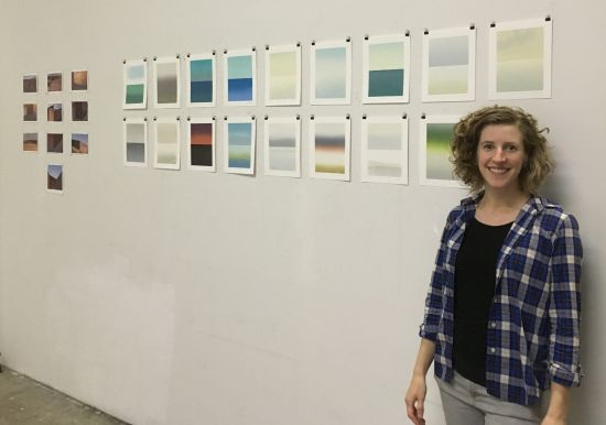 Anne Smith poses with a series of serene monoprints that capture the many moods of the Potomac River.
