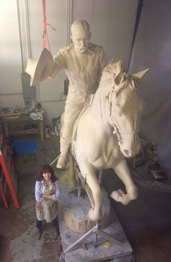 Blake posing with her life-sized plaster cast of Teddy Roosevelt. The finished piece will be placed at Roosevelt High School in DC. Photo courtesy of Margaret Boozer.