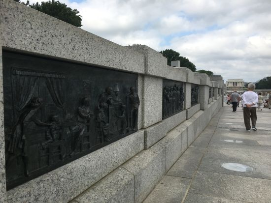 Friezes that Blake and sculptor Ray Kaskey produced line the central walkways of the World War II Memorial on the National Mall. Photo for East City Art by Eric Hope.