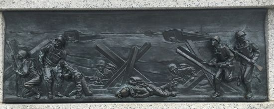 Detail of World War II Memorial frieze that captures soldiers racing ashore in three dimensions. Photo for East City Art by Eric Hope.