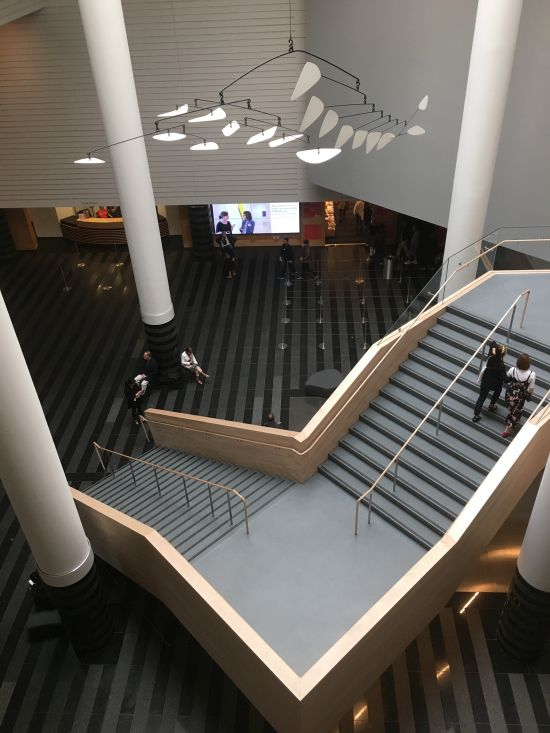 The lobby of the 1995 Botta building is now a light, airy space bisected by a stairwell leading to the museum's new ticket counter. Photo for East City Art by Eric Hope.