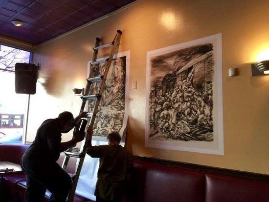 Michael Platt and Carol Beane installing works by Benjamin Abramowitz at 14th and V, NW, Busboys and Poets. Courtesy of Busboys and Poets.