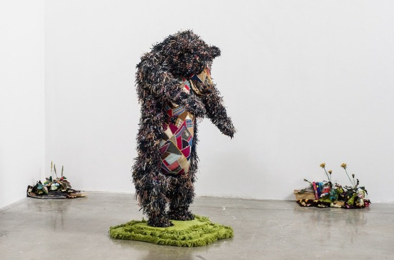 Aaron McIntosh, The Bear with Weeds, 2013, mixed-media fiber sculpture. Courtesy of Target Gallery.