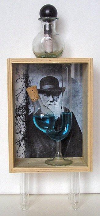 Martin Feldman, The Origin, assemblage including box, glass vials, photos, cork, water, 14x5.5x3 inches, 2014. Photo courtesy of Claudia Rousseau.