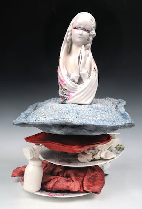 """Jessica Gardner; Sleep When the Baby Sleeps; slip-cast multiples, slip dip fabric; re-fired found objects, ceramic decals; 20""""x18""""x18""""; photo courtesy of the Margaret W. & Joseph L. Fisher Gallery"""