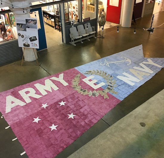 The nearly completed 25-ft Highest Honor banner, designed by artist Andy Yoder. Courtesy of The Art League.