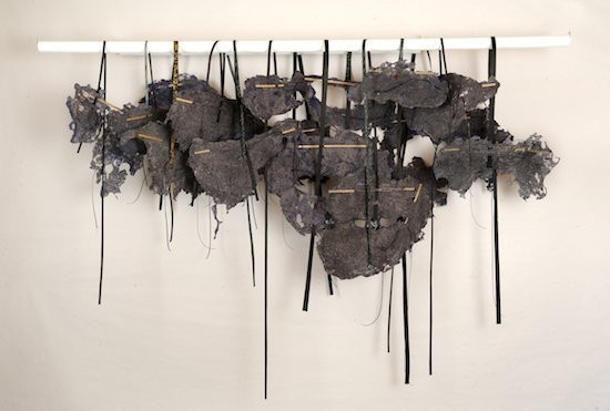 Industrial Smog, from Toxicity in the Air, 2016 (handmade and remade paper, acrylic, vinyl cord, tar paper, vinyl covered pine rod), photograph by Greg Staley. Courtesy of DCAC.