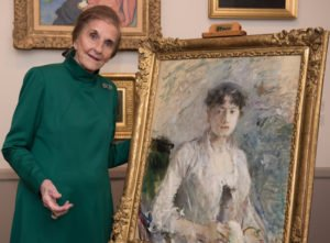 National Museum of Women in the Arts Founder Wilhelmina Cole Holladay standing near Berthe Morisot, Jeune Femme en Mauve (Young Woman in Mauve), 1880; Oil on canvas, 28 x 23 in.; Gift of Joe R. and Teresa Lozano Long; Photo © 2017 Margot Schulman.
